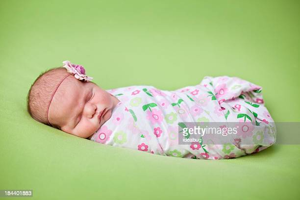 Color Photo of Newborn Baby Girl on Green Background