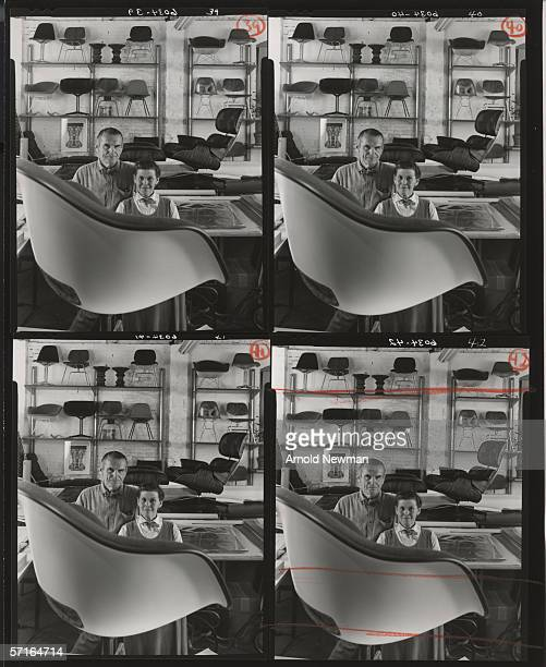 Color photograph of a black and white contact sheet of portraits of American designers and married couple Charles and Ray Eames who stand behind a...