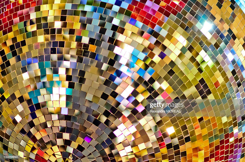 Color pixels from massive Christmas disco ball : Stock Photo