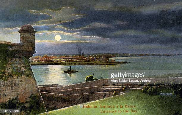 Color postcard of Morro Castle at night with Havana across the harbor Havana Cuba circa 1915
