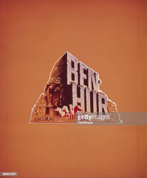 Color poster publicizing the epic movie Ben Hur 1959 A chariot race is depicted against a bright orange background