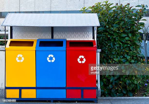 color recycle bin - garbage bin stock pictures, royalty-free photos & images