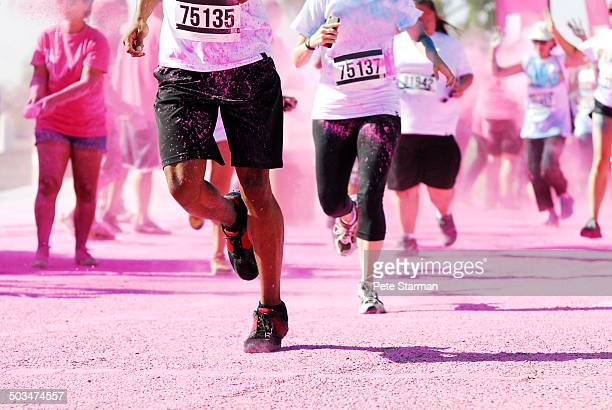 5K Color Run competitors running through pink dye.
