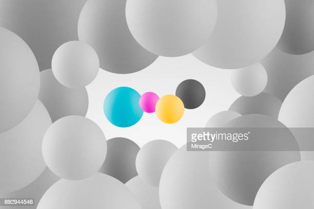 cmyk color spheres against monochrome spheres - bouncing ball stock photos and pictures