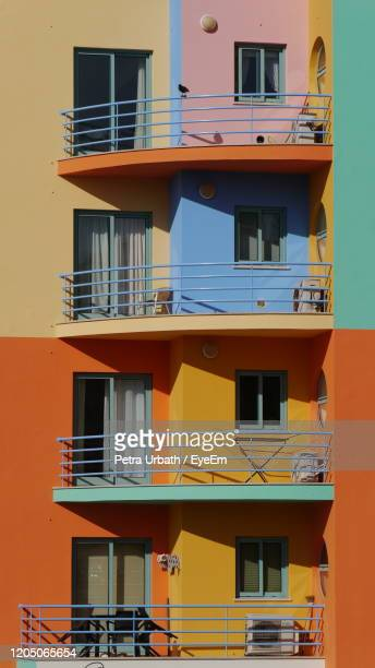 color up your life with colorful facade of building with balconies - アルブフェイラ ストックフォトと画像