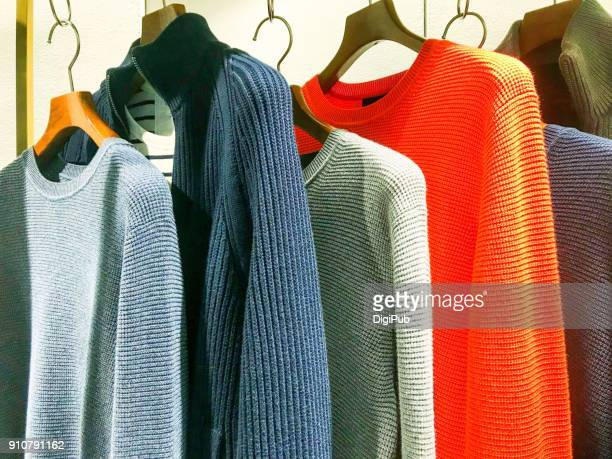 Color variations of men's sweater hanging in rack