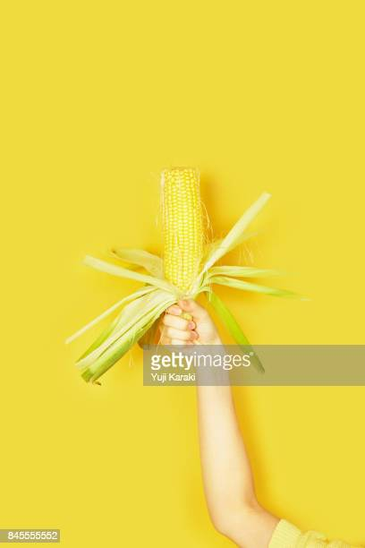 color veggies - corn on the cob stock pictures, royalty-free photos & images