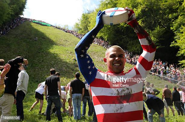 Colorada Springsbased American Kenny Rackers celebrates winning the first race at Cooper's Hill during the annual Bank Holiday tradition of...