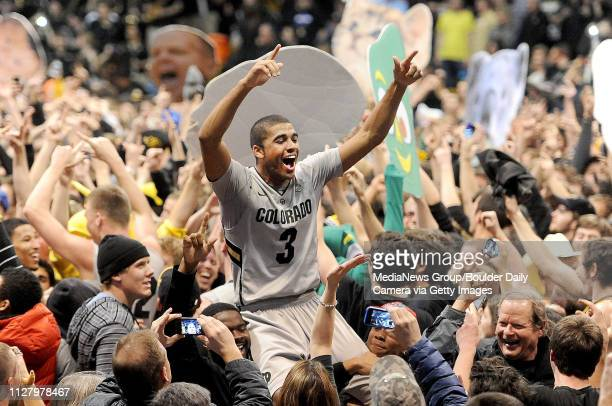 Colorado Arizona NCAA Men213Xavier Talton is carried off the court by CU fans that rushed the court after CU beat Arizona 7158