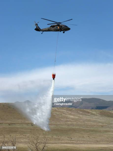 Colorado Army National Guard firefighter training Black Hawk helicopter drops water Bear Creek Lake Park Colorado