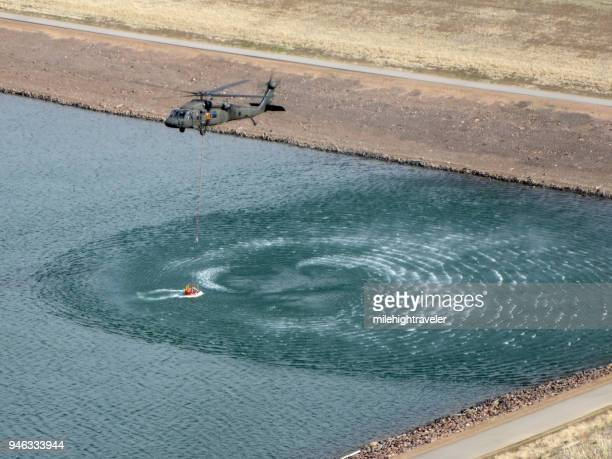 Colorado Army National Guard firefighter training Black Hawk helicopter scoops water Bear Creek Reservoir Colorado