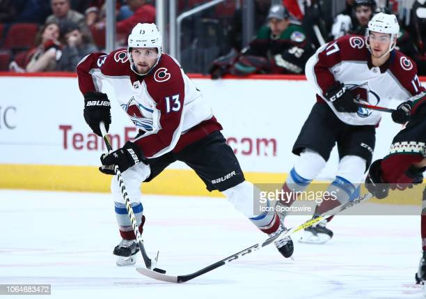 Colorado Avalanche center Alexander Kerfoot skates with the puck during the NHL hockey game between the Arizona Coyotes and the Colorado Avalanche on...