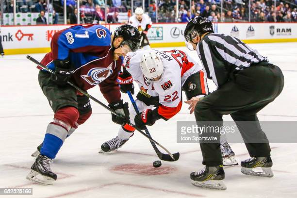 Colorado Avalanche Center John Mitchell and Ottawa Senators Center Chris Kelly fight for puck during face off during the Ottawa Senators and Colorado...
