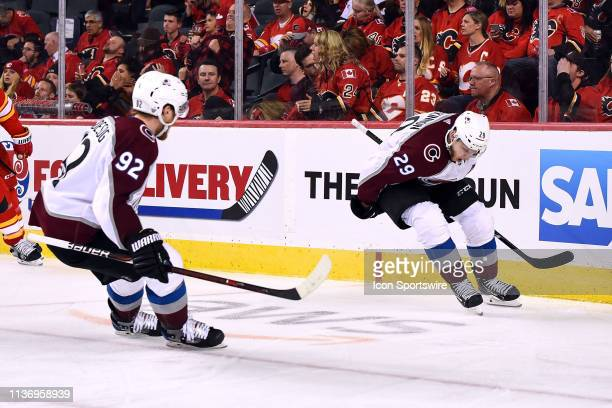 Colorado Avalanche Center Nathan MacKinnon celebrates with Left Wing Gabriel Landeskog after scoring the winning goal during the first overtime...