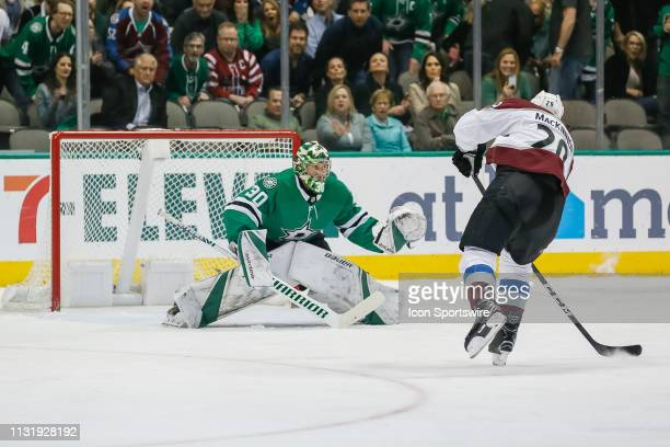 Colorado Avalanche center Nathan MacKinnon shoots the puck on a breakaway against Dallas Stars goaltender Ben Bishop during the game between the...