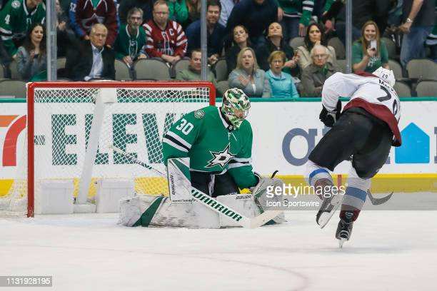 Colorado Avalanche center Nathan MacKinnon shoots the puck on a breakaway against Dallas Stars goaltender Ben Bishop as Bishop blocks the shot during...