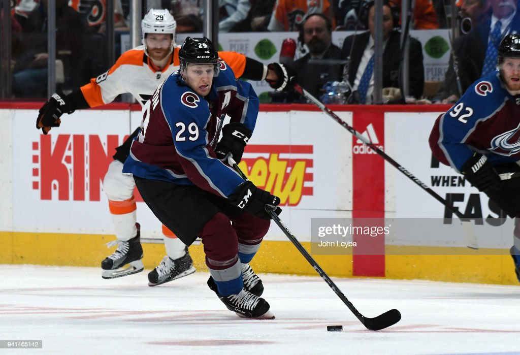 Colorado Avalanche center Nathan MacKinnon (29) skates down ice with the puck against the Philadelphia Flyers on March 28, 2018 at Pepsi Center in Denver, Colorado.
