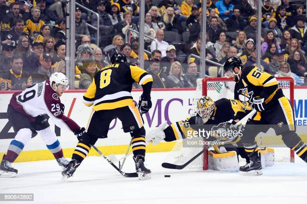 Colorado Avalanche Center Nathan MacKinnon tries to put a shot on Pittsburgh Penguins Goalie Tristan Jarry from behind the goal line as Pittsburgh...