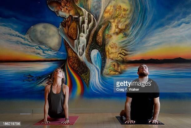 Colorado Avalanche Center Ryan O'Reilly right and his girlfriend Dayna Douros practice Ashtanga Vinyasa yoga at the Samadhi Center for Yoga in Denver...