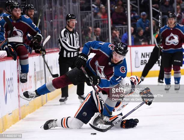 Colorado Avalanche center Tyson Jost battles for control of the puck against Edmonton Oilers right wing Josh Currie in the first period at the Pepsi...