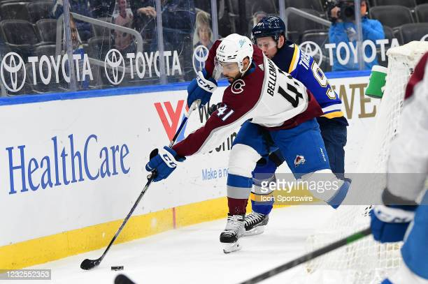 Colorado Avalanche centerman Pierre-Edouard Bellemare controls the puck with pressure from St. Louis Blues right wing Vladimir Tarasenko during a NHL...
