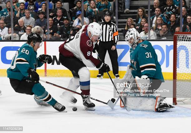 Colorado Avalanche defenseman Cale Makar attacks but San Jose Sharks left wing Marcus Sorensen jabs the puck away in front of San Jose Sharks...