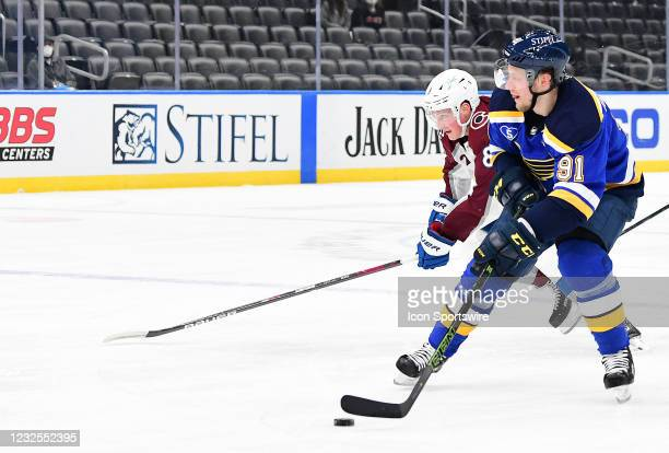Colorado Avalanche defenseman Cale Makar competes for the puck with St. Louis Blues right wing Vladimir Tarasenko during a NHL game between the...