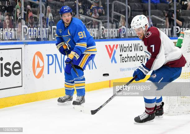 Colorado Avalanche defenseman Devon Toews passes the puck as St. Louis Blues right wing Vladimir Tarasenko looks on during a NHL game between the...