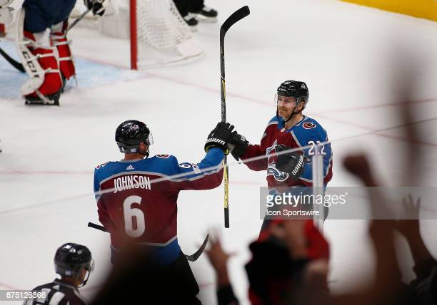 Colorado Avalanche defenseman Erik Johnson congratulates center Colin Wilson after his goal in the second period during a regular season game between...
