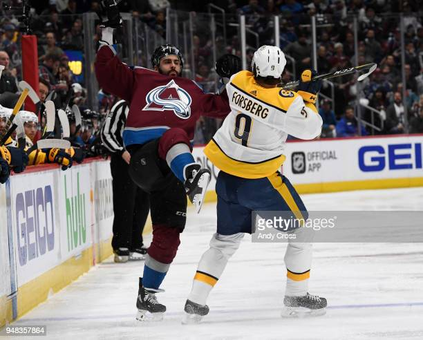 Colorado Avalanche defenseman Mark Barberio an Nashville Predators left wing Filip Forsberg crash into each other in the first period during the...
