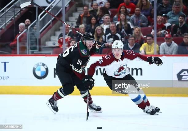 Colorado Avalanche defenseman Nikita Zadorov battles for the puck during the NHL hockey game between the Arizona Coyotes and the Colorado Avalanche...