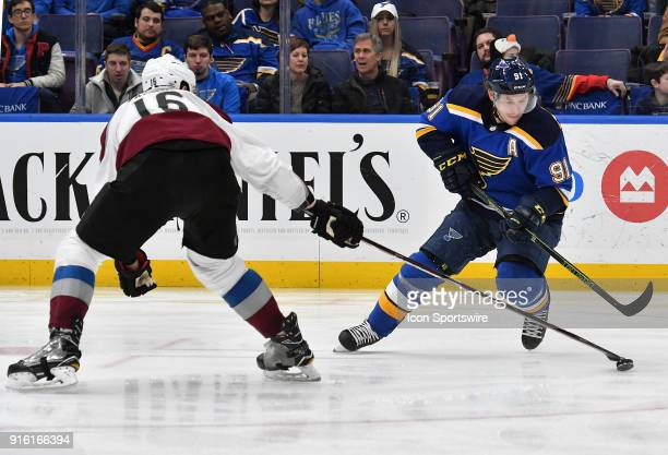 Colorado Avalanche defenseman NNikita Zadorov takes the puck away from St Louis Blues right wing Vladimir Tarasenko during a NHL game between the...