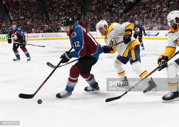 Colorado Avalanche defenseman Patrik Nemeth works the puck against Nashville Predators center Kyle Turris in the first period during the third game...