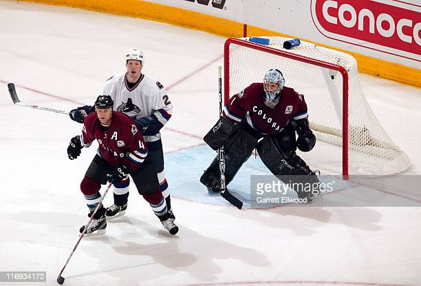 Colorado Avalanche defenseman Rob Blake and goalie David Aebischer protect the goal from a Vancouver Canucks player during the game between the...