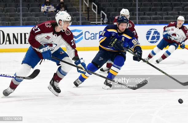 Colorado Avalanche defenseman Ryan Graves and St. Louis Blues right wing Vladimir Tarasenko go after the puck during a NHL game between the Colorado...