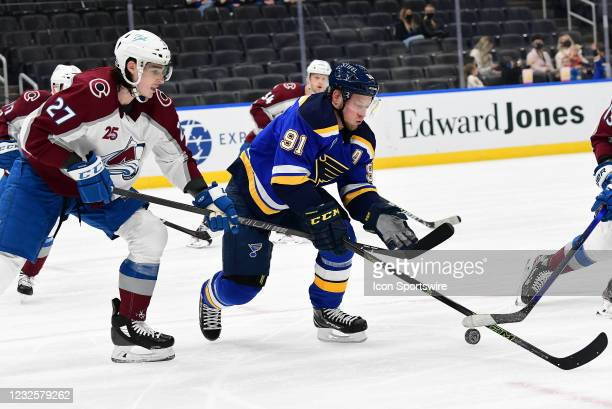Colorado Avalanche defenseman Ryan Graves and St. Louis Blues right wing Vladimir Tarasenko compete for the puck during a NHL game between the...