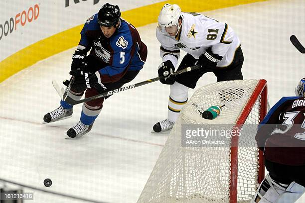Colorado Avalanche defenseman Shane O'Brien controls the puck away from Dallas Stars center Tomas Vincour during the second period of an exhibition...