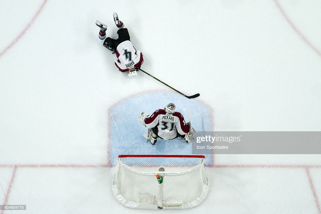 Colorado Avalanche defenseman Tyson Barrie (4) lays on the ice after getting hit by a puck in the 3rd period during the Central Division match up between the Colorado Avalanche and the Minnesota Wild on November 19, 2016, at Xcel Energy Center in St. Paul, Minnesota.
