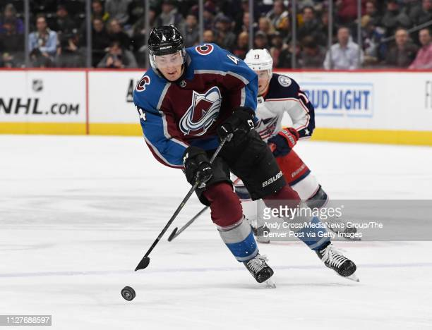 Colorado Avalanche defenseman Tyson Barrie skates the puck down ice against Columbus Blue Jackets right wing Cam Atkinson in the third period at the...