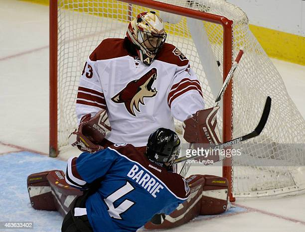 Colorado Avalanche defenseman Tyson Barrie takes a shot on Arizona Coyotes goalie Mike McKenna and hits the back of the net or a goal during the...