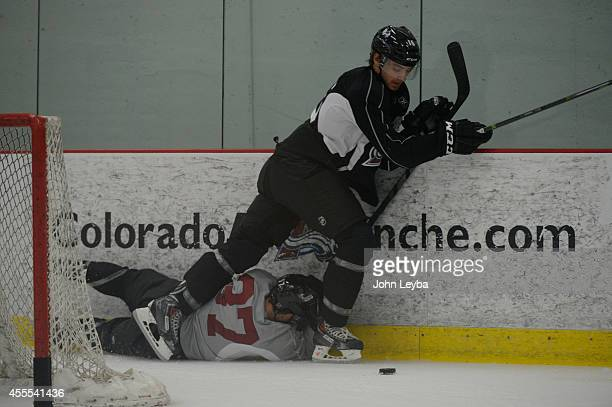 Colorado Avalanche Duncan Siemens shoves Colin Smity up against the boards during rookie camp September 16 2014 at Family Sports Center