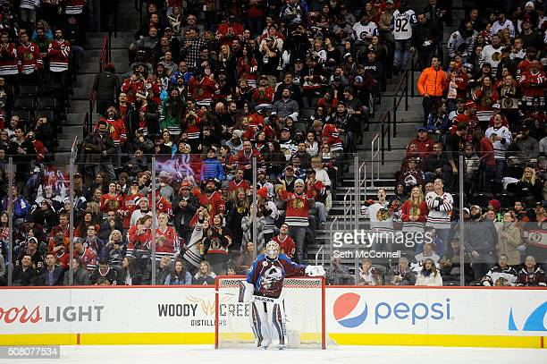 Colorado Avalanche goalie Calvin Pickard watches the replay on the scoreboard after giving up a second goal to the Chicago Blackhawks during the...
