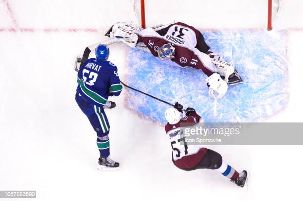 Colorado Avalanche Goalie Philipp Grubauer slides to make a save on Vancouver Canucks center Bo Horvat during their NHL game at Rogers Arena on...