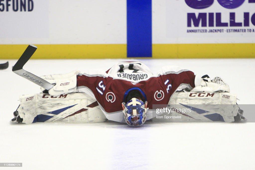 Colorado Avalanche Goalie Philipp Grubauer Stretches Prior To The