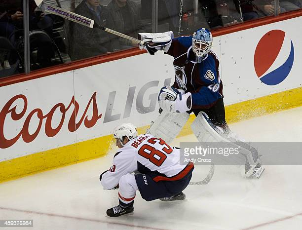 Colorado Avalanche goalie Reto Berra advances the puck down ice against an advancing Washington Capitals center Jay Beagle in the second period at...