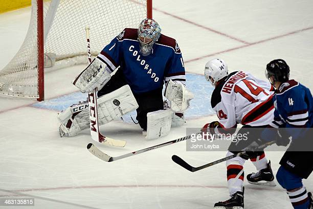 Colorado Avalanche goalie Semyon Varlamov makes a save on a shot by New Jersey Devils center Adam Henrique during the second period January 16 2014...