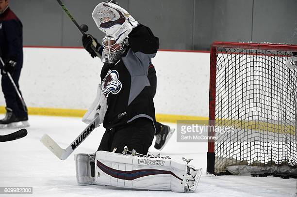 Colorado Avalanche goaltender Calvin Pickard gloves down a shot during the first day of training camp at Family Sports Ice Arena in Centennial...