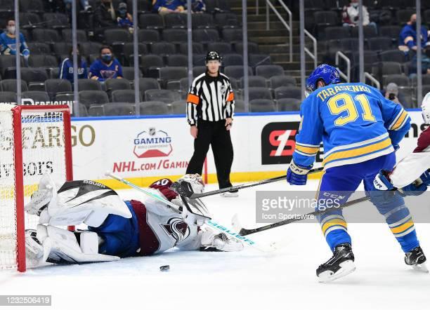 Colorado Avalanche goaltender Devan Dubynk blocks a shot on goal bin St. Louis Blues right wing Vladimir Tarasenko during a NHL game between the...