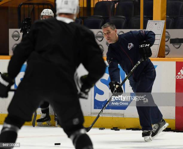 Colorado Avalanche head coach Jared Bednar sends the puck during practice before game five of round one of the Stanley Cup Playoffs against the...