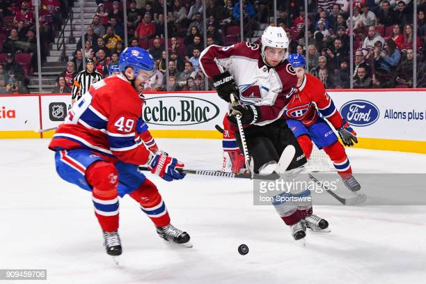 Colorado Avalanche Left Wing Alexander Kerfoot shoots the puck away from Montreal Canadiens Right Wing Logan Shaw during the Colorado Avalanche...